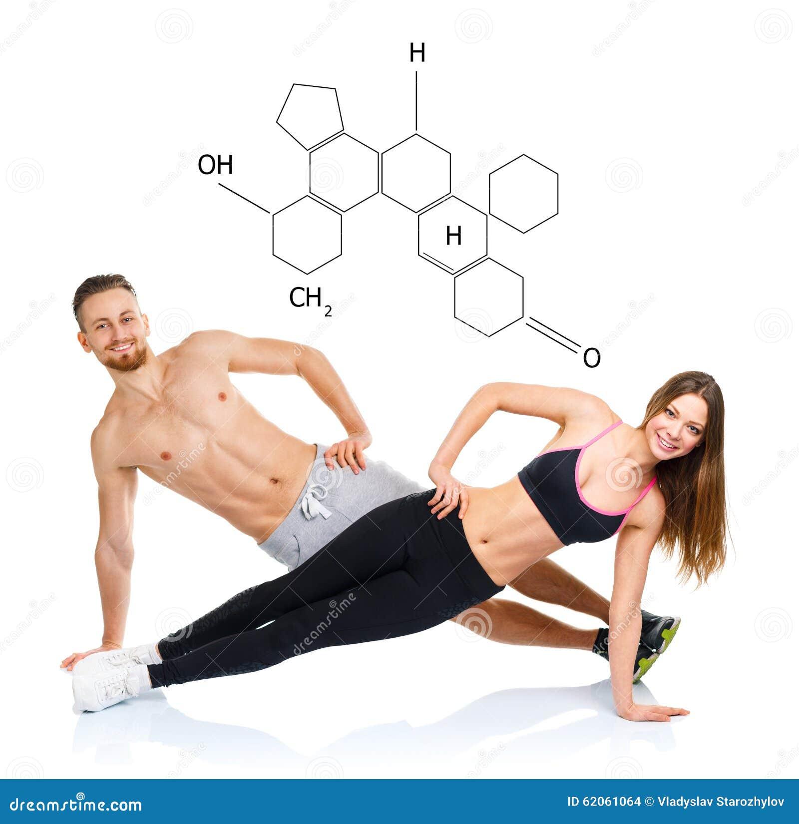 运动有吸引力的夫妇-做健身exercis的男人和妇女
