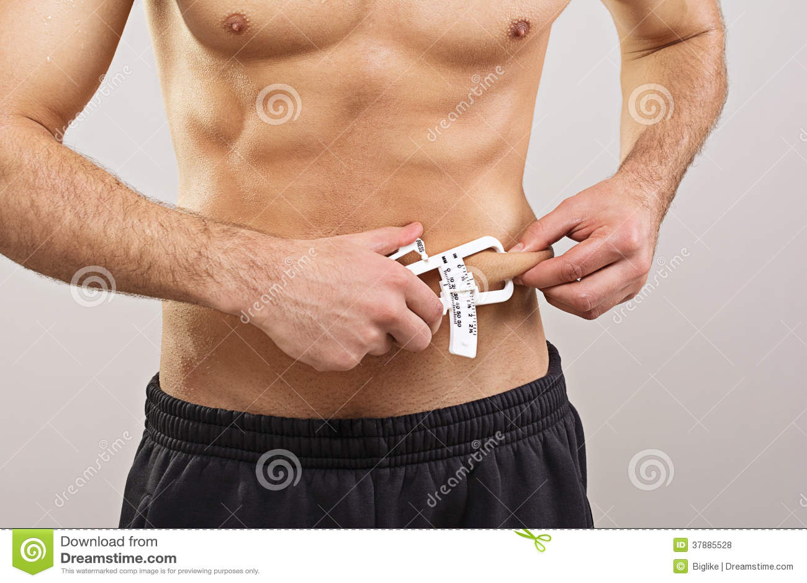 适合的与轮尺的运动员测量的体脂肪