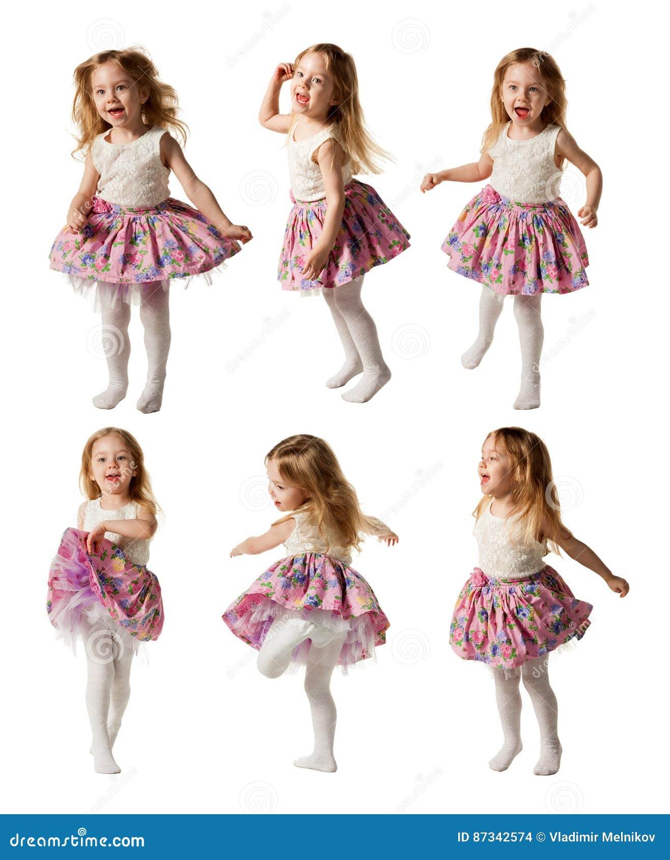 逗人喜爱的小女孩在白色bac唱歌曲和跳舞隔绝了