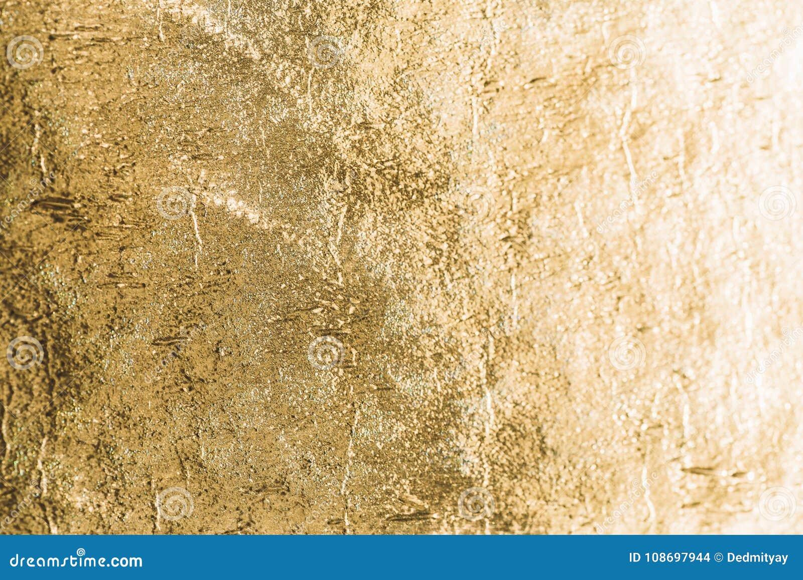 金发光的箔背景,黄色光泽金属纹理