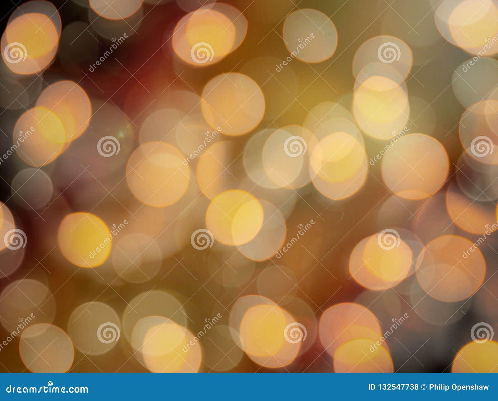 金黄桔子被弄脏的欢乐党光发光的被弄脏的抽象背景
