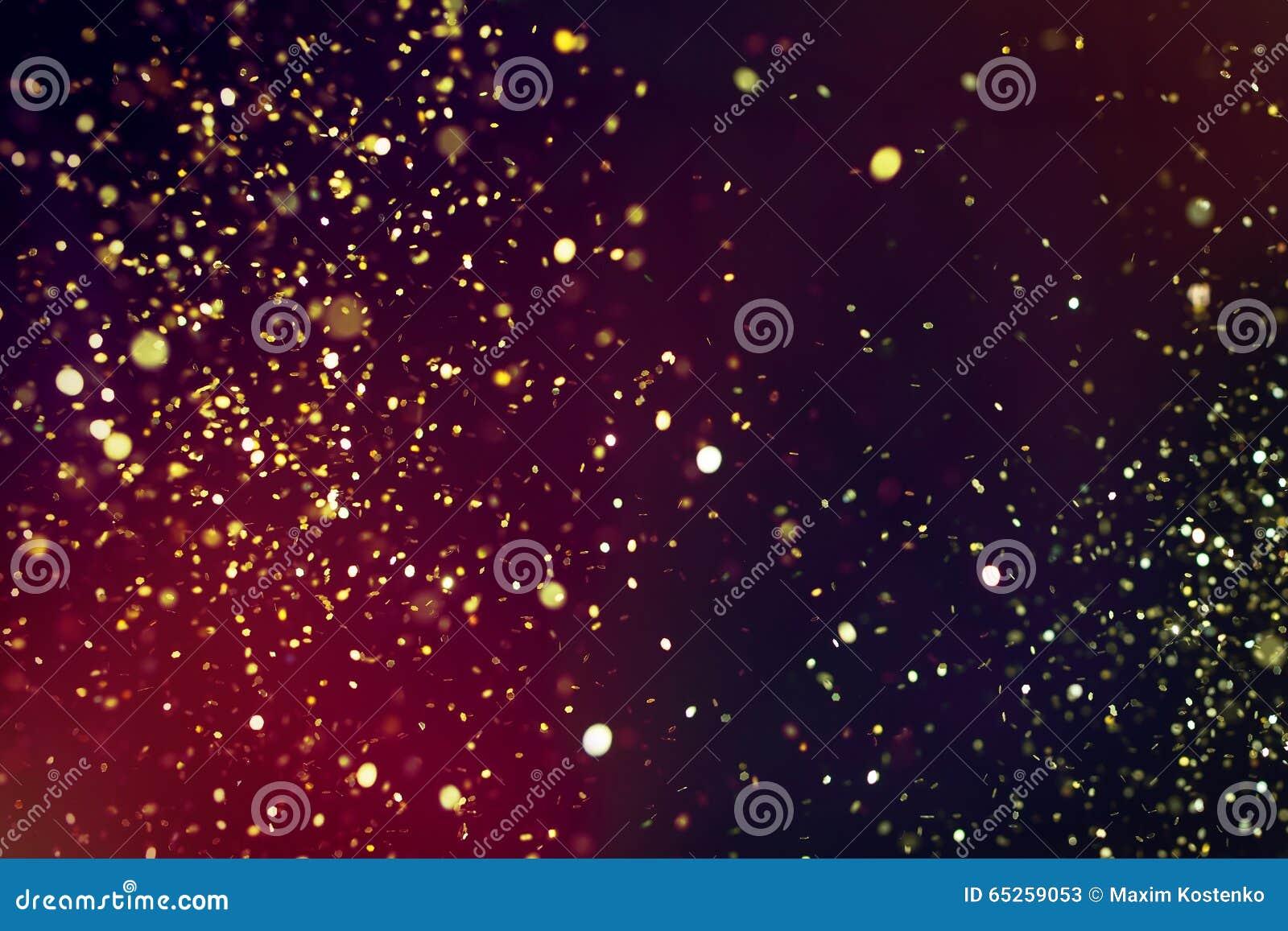 金黄闪烁照片在黑背景的 金黄的展开
