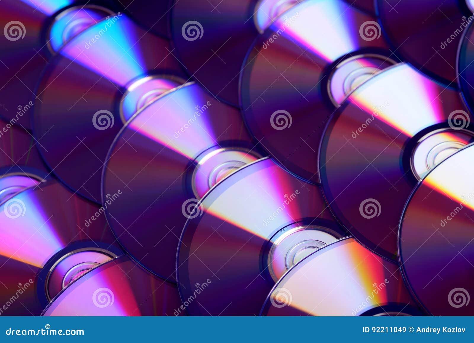 雷射唱片背景 几个CD的dvd Blu-ray圆盘 光学可录或可再写的数字资料存贮