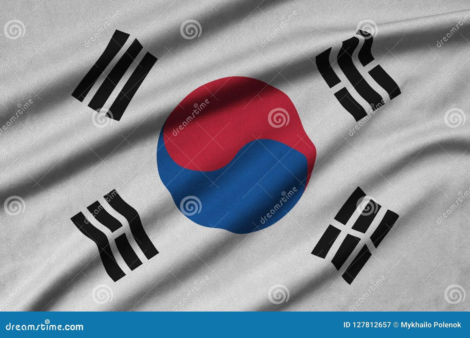 韩国旗子在与许多折叠的体育布料织品被描述 体育队横幅