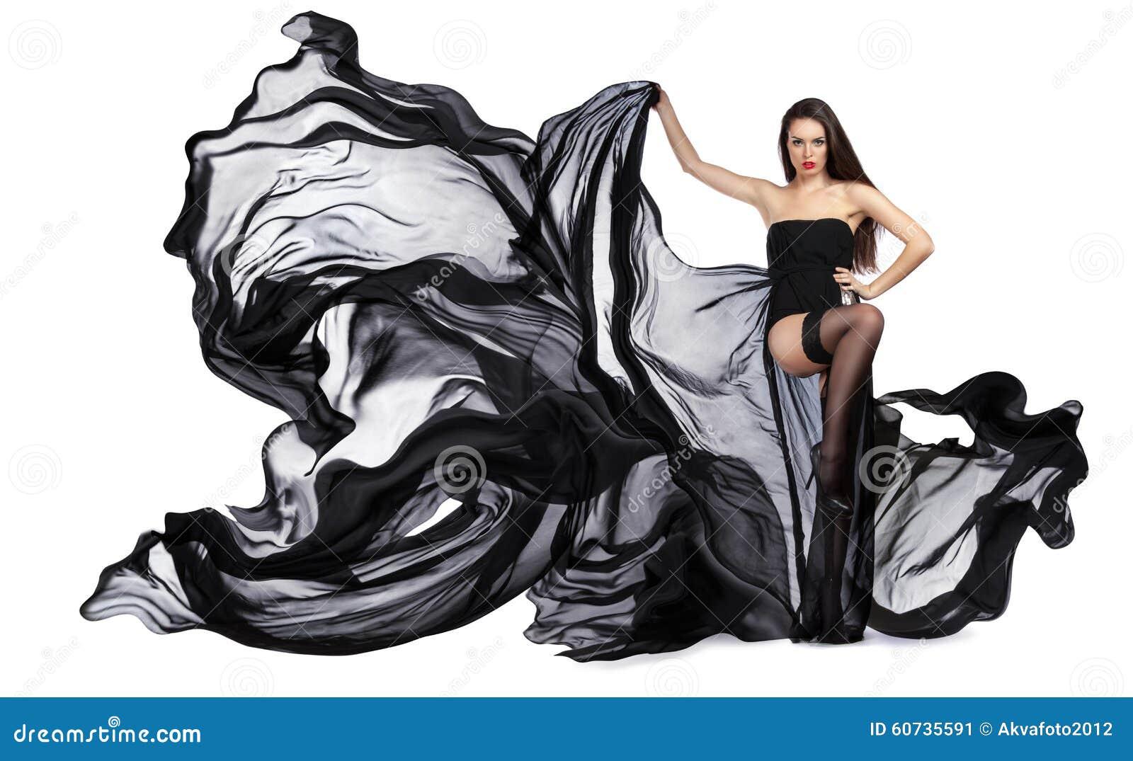 飞行的黑礼服美丽的女孩 织品流