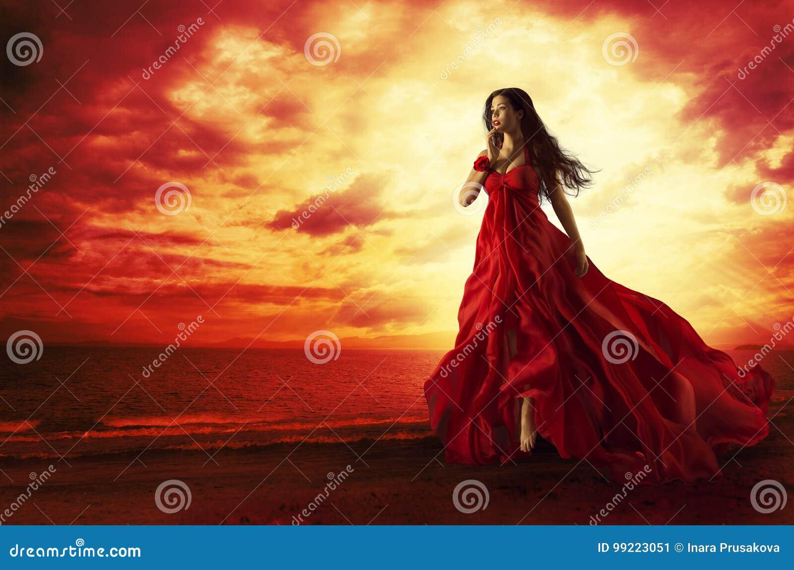 飞行红色礼服,在晚礼服浮动的时装模特儿的妇女