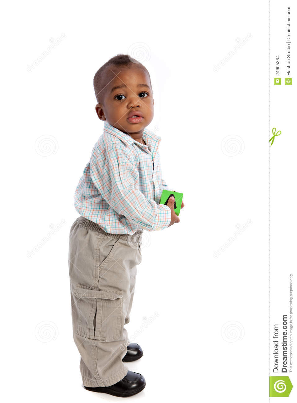 1 year old baby boy standing holding a block stock photo
