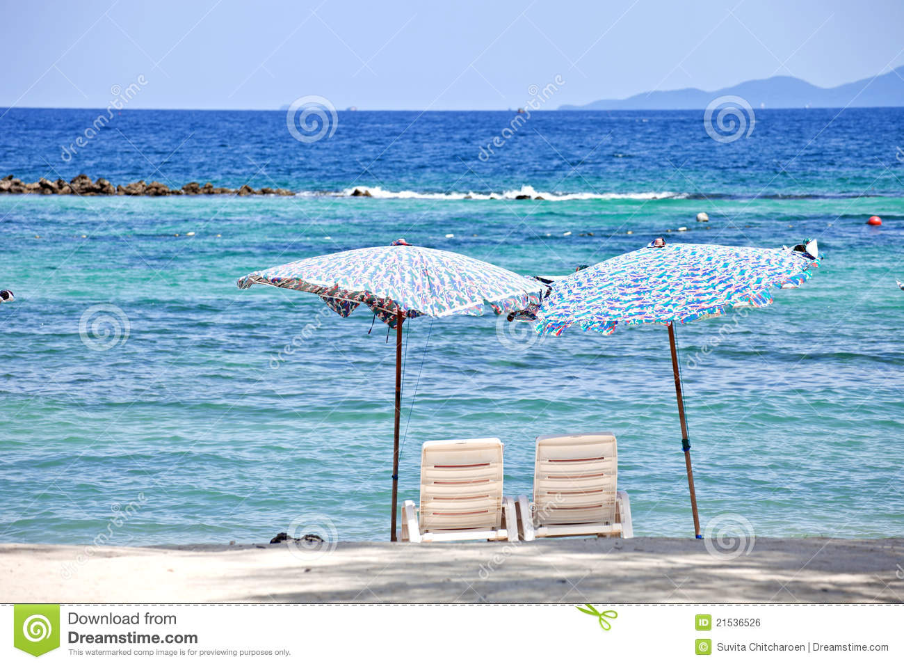 2 beach chairs on the beach - 2 Chairs On Beach In Front Of The Sea
