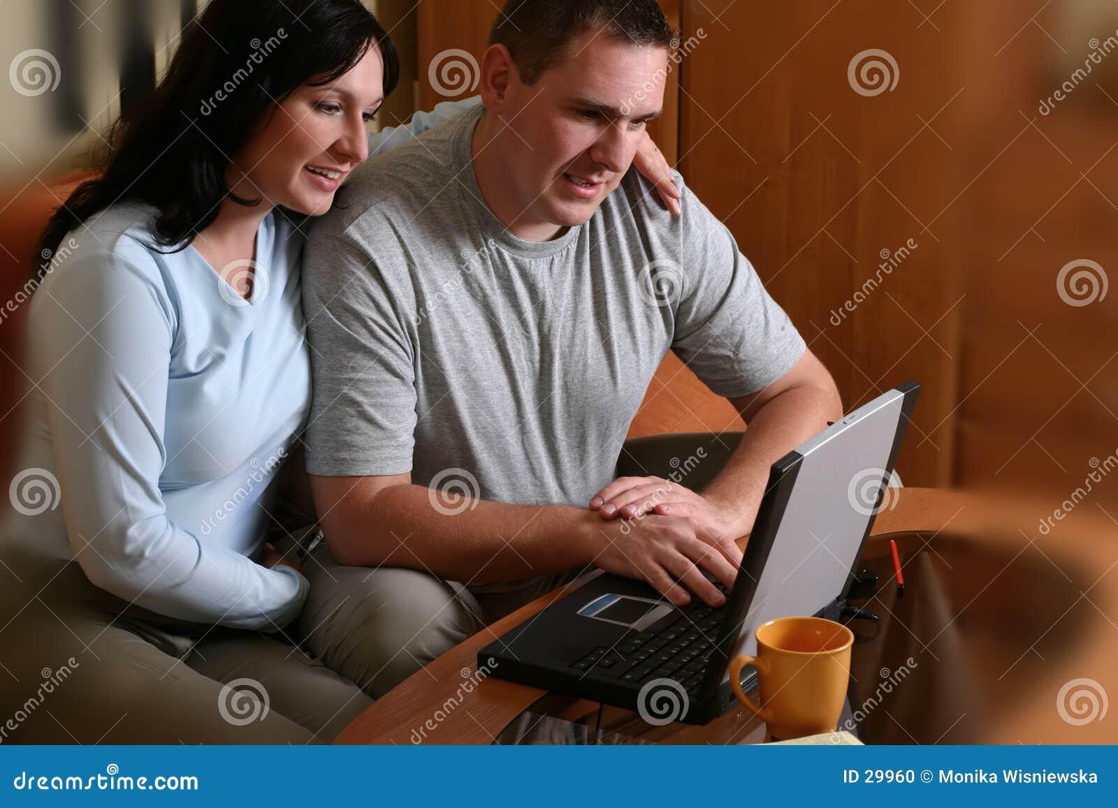 2 couple happy laptop