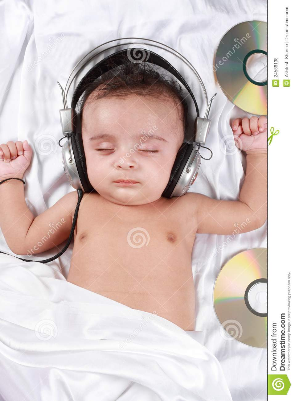 2 month old baby listening to music