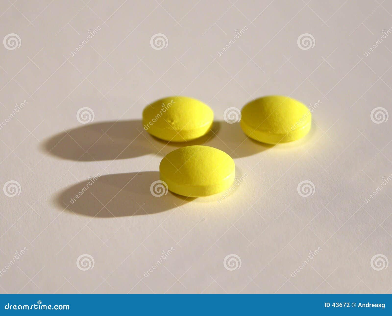 3 comprimidos amarelos