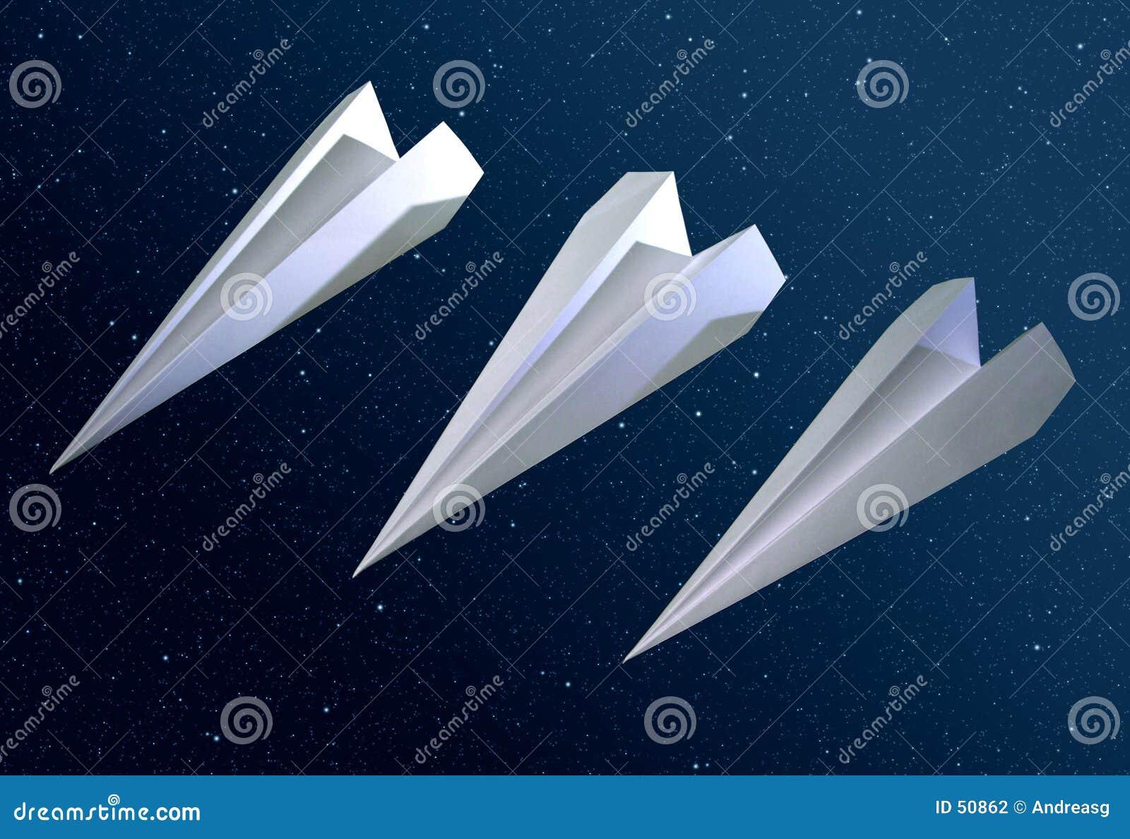 3 foguetes do origami no espaço