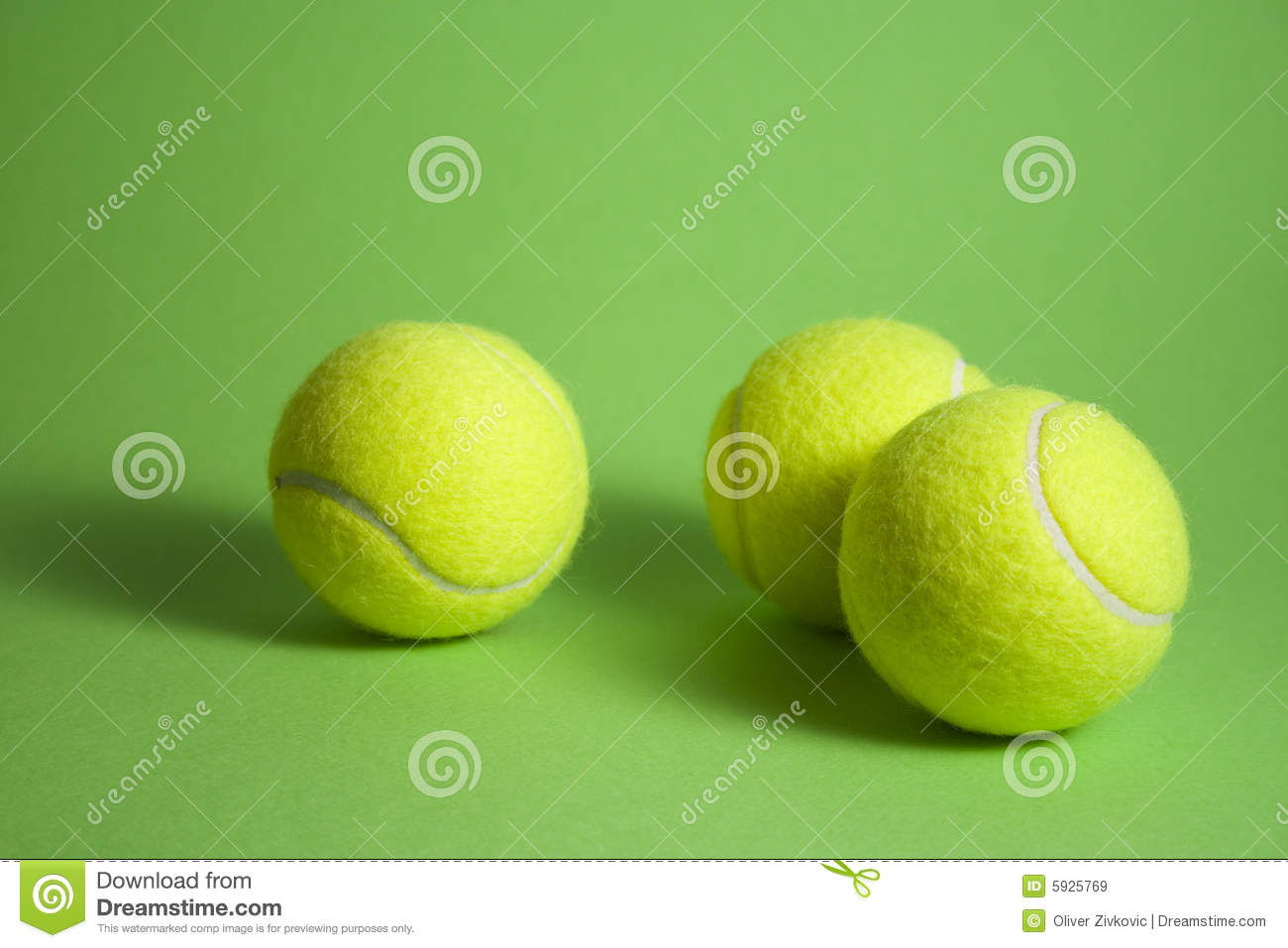 3 tennis balls ond green background