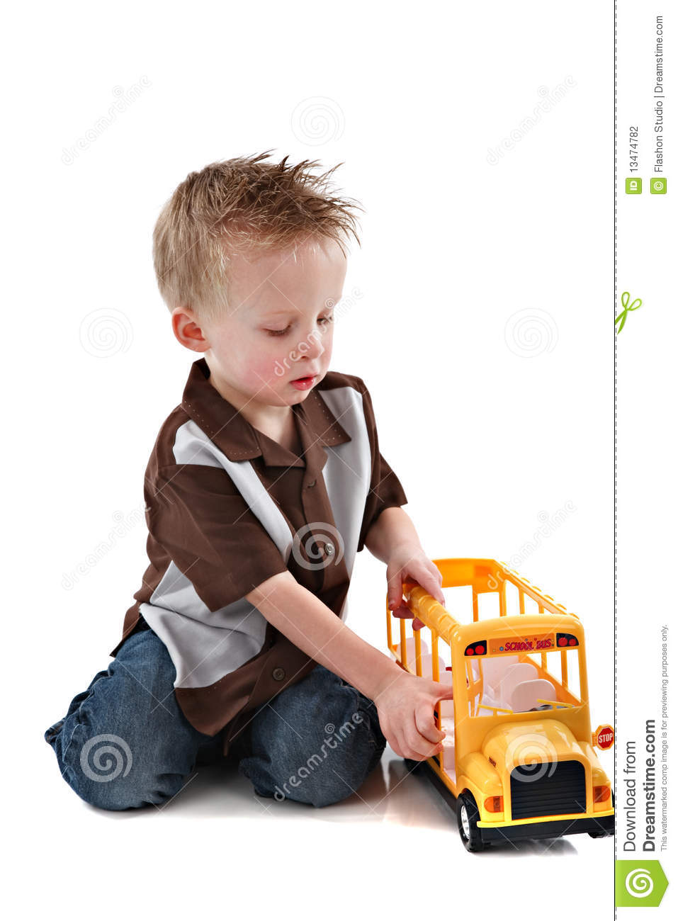 4 Year Boy Bedroom Decorating Ideas: 4 Year Old Boy Plying With Yellow School Bus Toy Stock