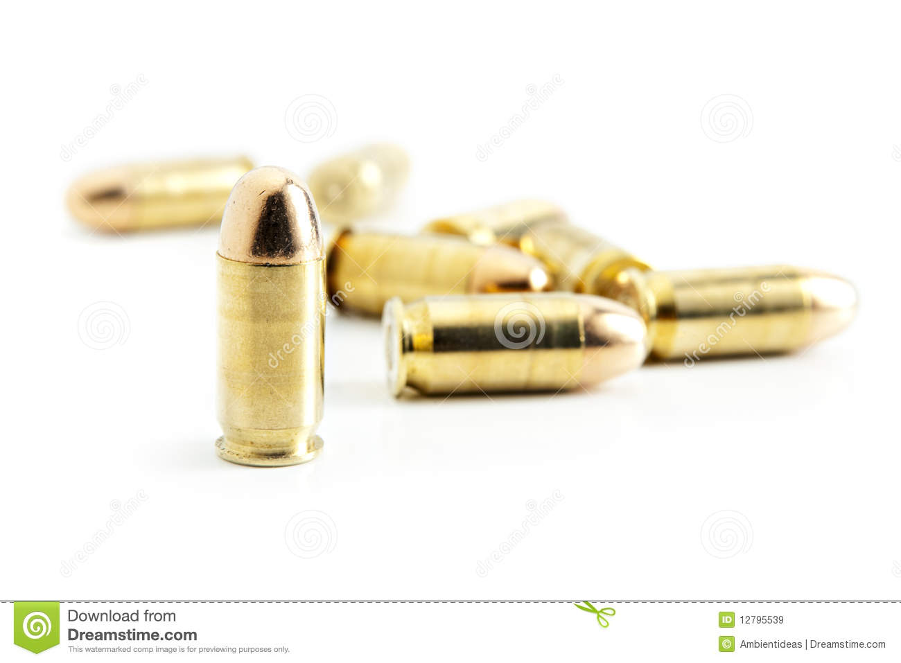 45 caliber bullets on white critical focus on bullet standing upright