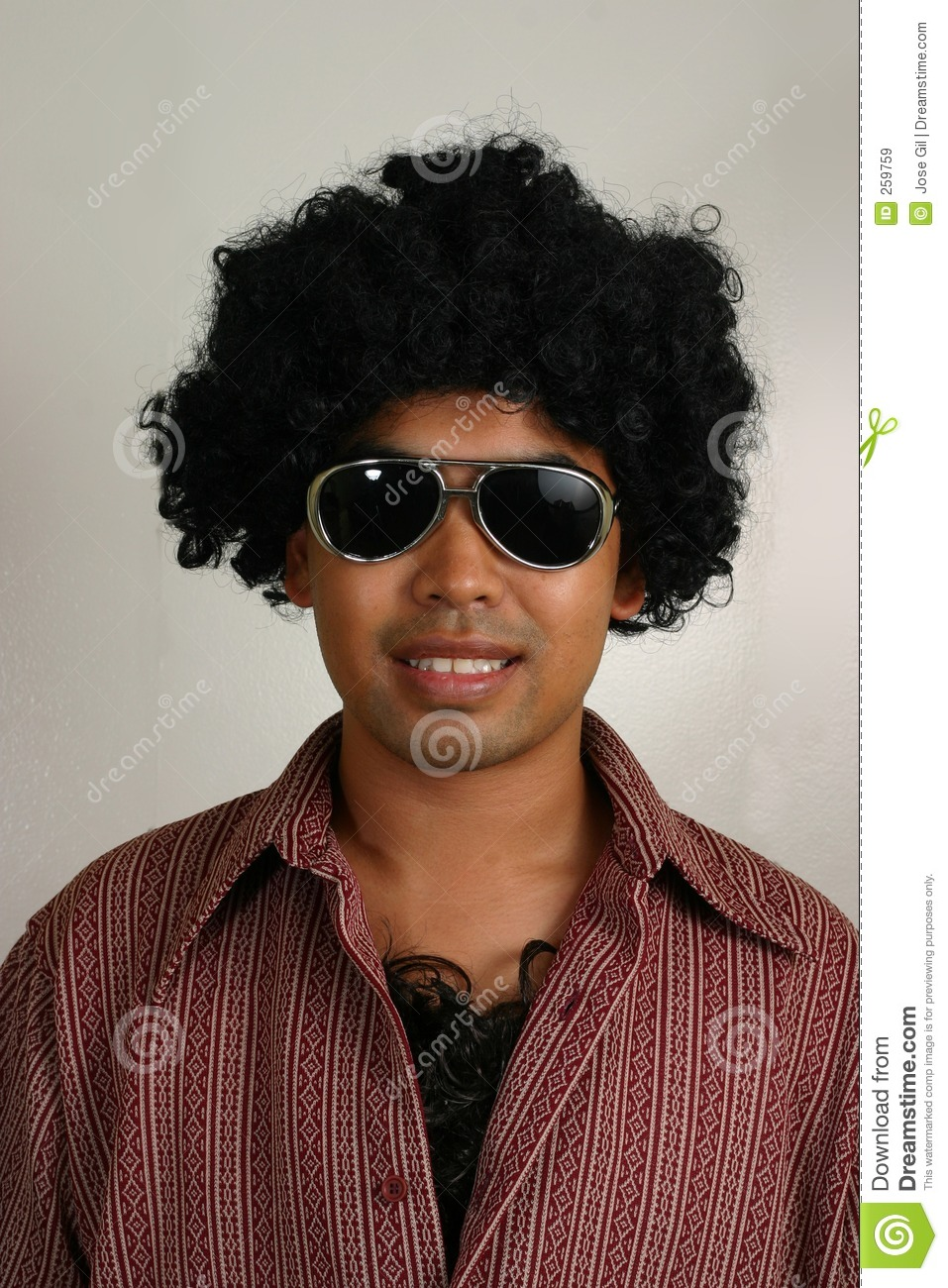 Dark complexion man ( Asian / Filipino / pass as Latino) in 70s afro, hairy  chest and sunglasses
