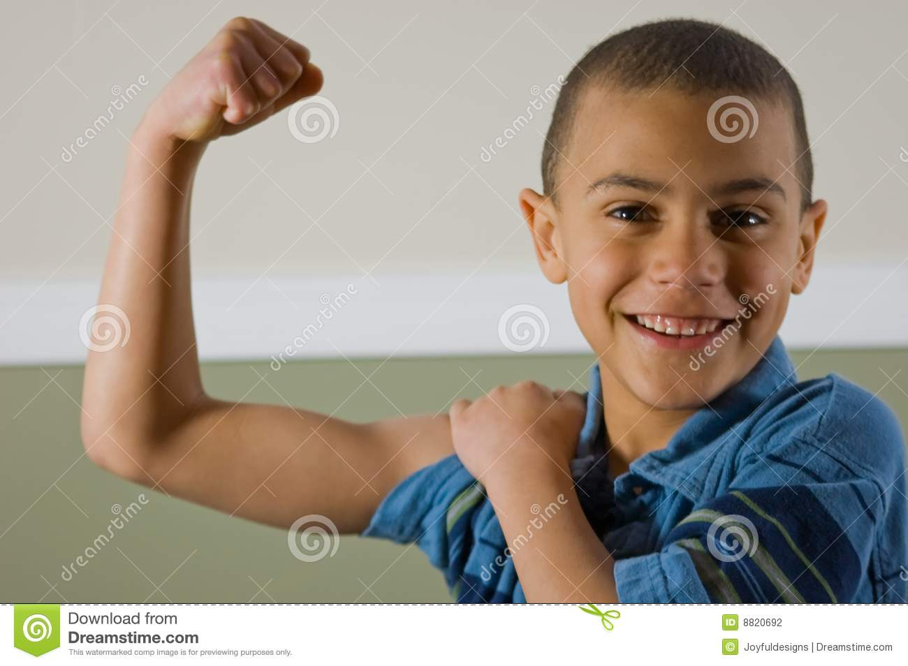 9 Year Old Boy Showing Off His Muscles Stock Photo Image