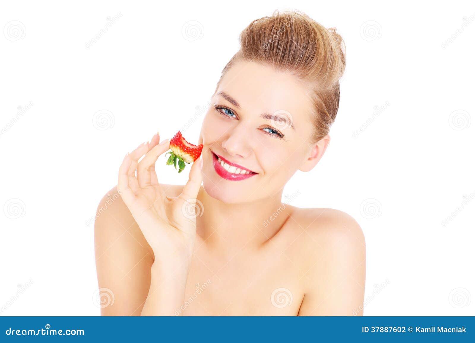 Aardbeibeet en vrouw