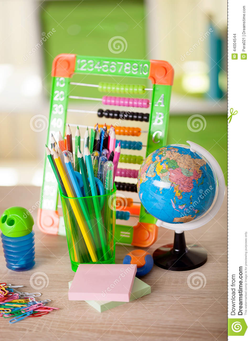 Abacus,globe, books and pencils on table,back to s