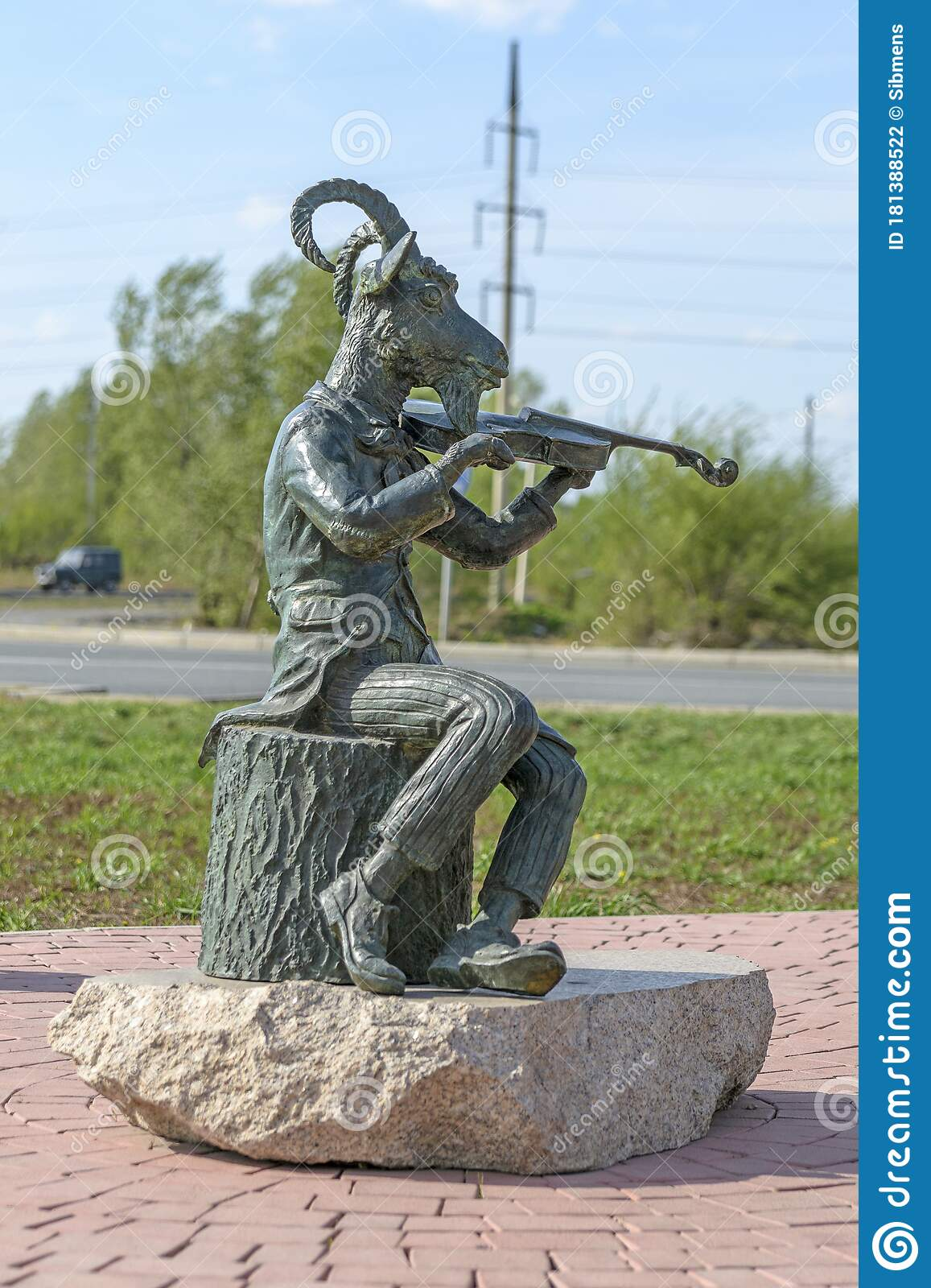 Abakan Russia 05 02 2020 Bronze Monument A Goat Dressed In A Tailcoat Plays The Violin While Sitting On A Stump Stock Photo Image Of Cute Garden 181388522