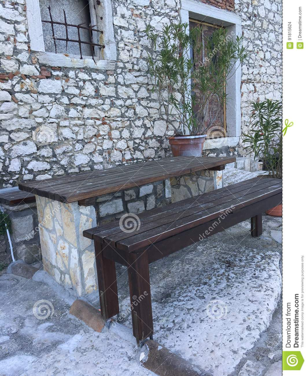 An Abandoned Building And A Stone Picnic Table Stock Photo Image - Stone picnic table