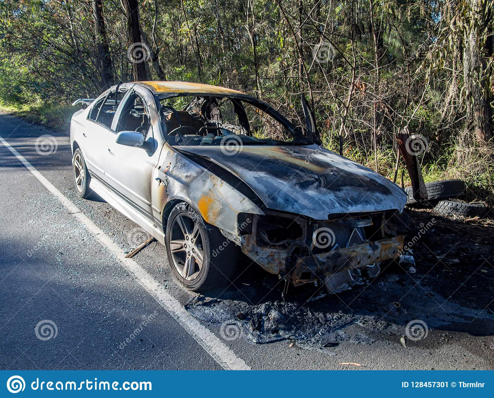 Abandoned Burnt Out Car At The Road Side Front Image Stock