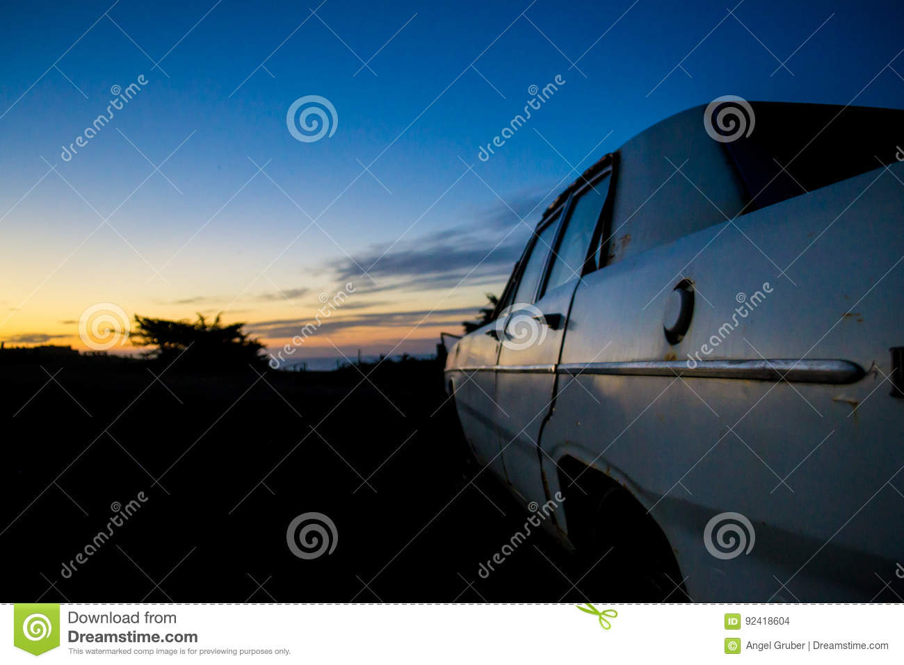 Abandoned car in the twilight