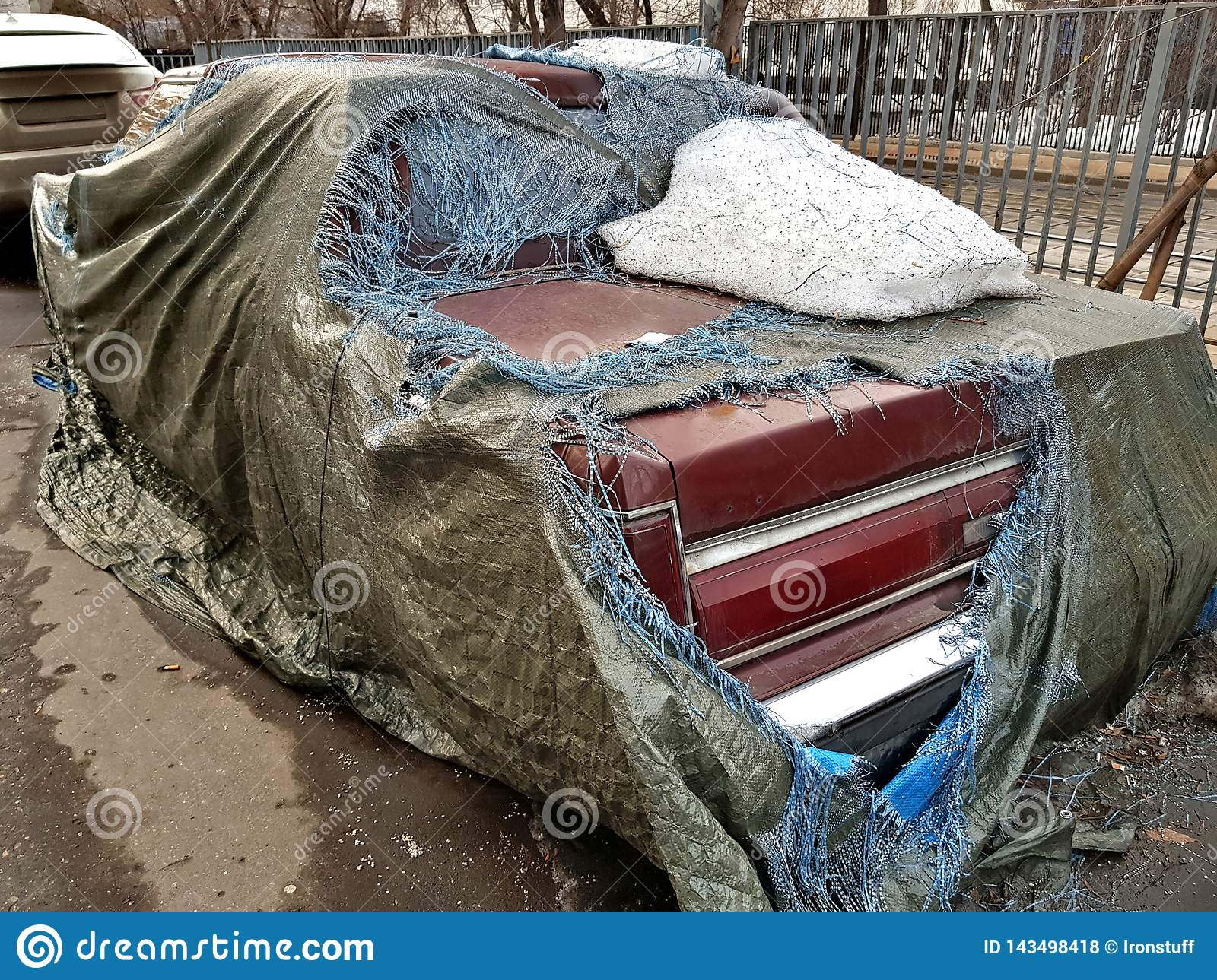 Abandoned car under the cover