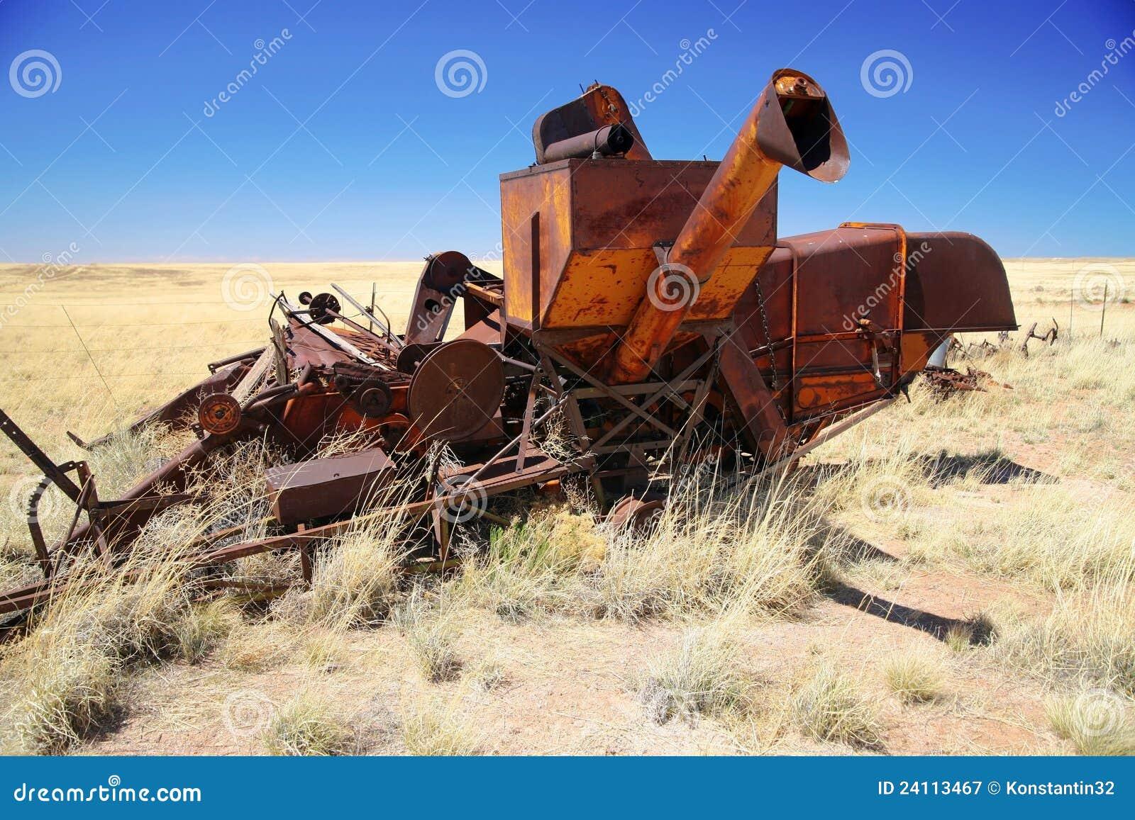 abandoned combine harvester stock image