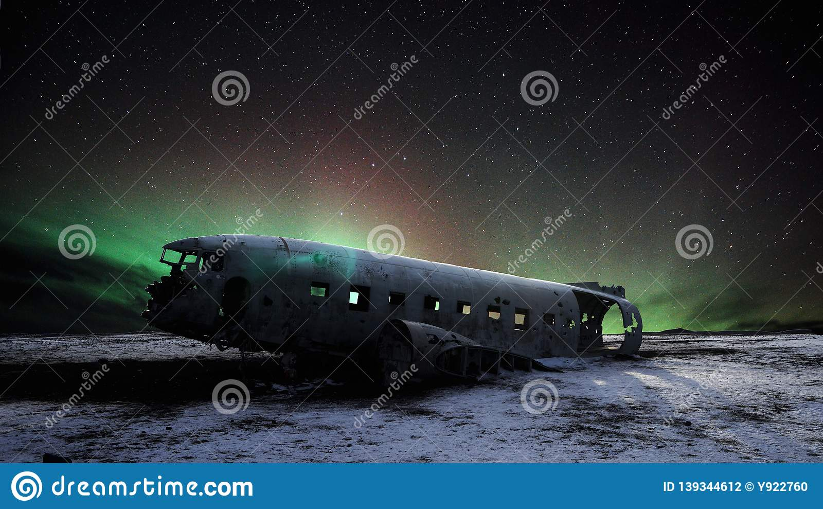 Abandoned DC plane in Iceland with aurora northern light and star background