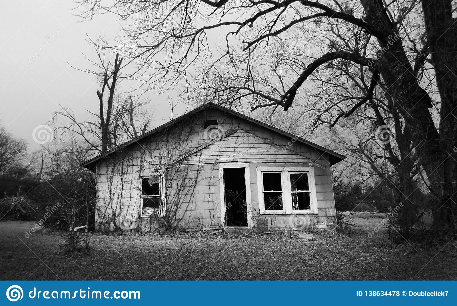 Stupendous Abandoned Empty Old House With Dead Trees Stock Photo Home Interior And Landscaping Ologienasavecom