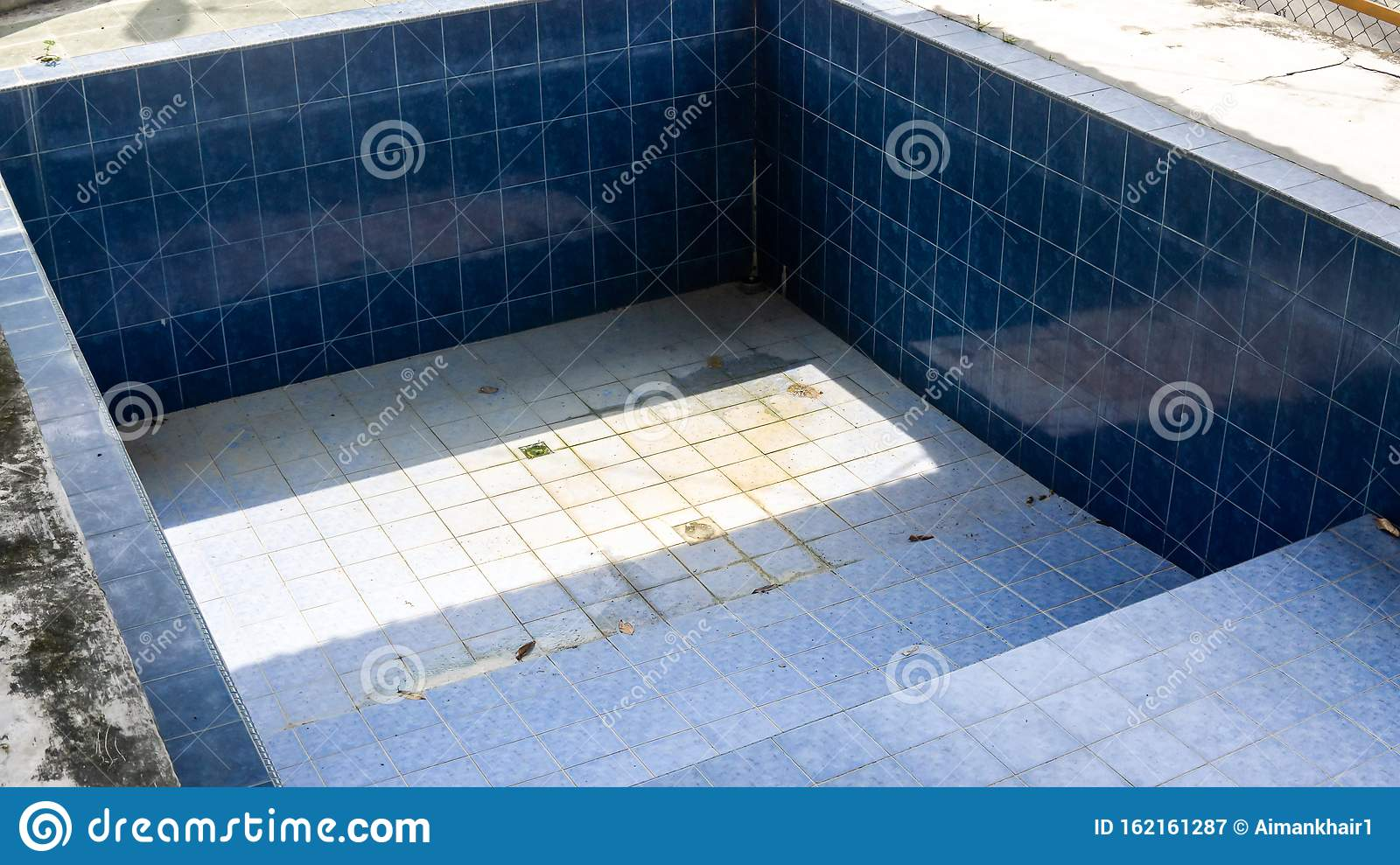 An Abandoned And Empty Outdoor Swimming Pool Under A Roof During The Day Stock Image Image Of Garbage Background 162161287
