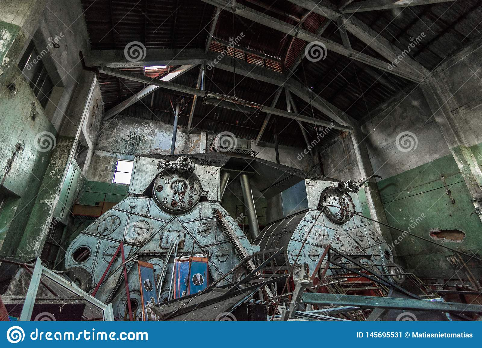 Abandoned factory hangar with giant antique boilers