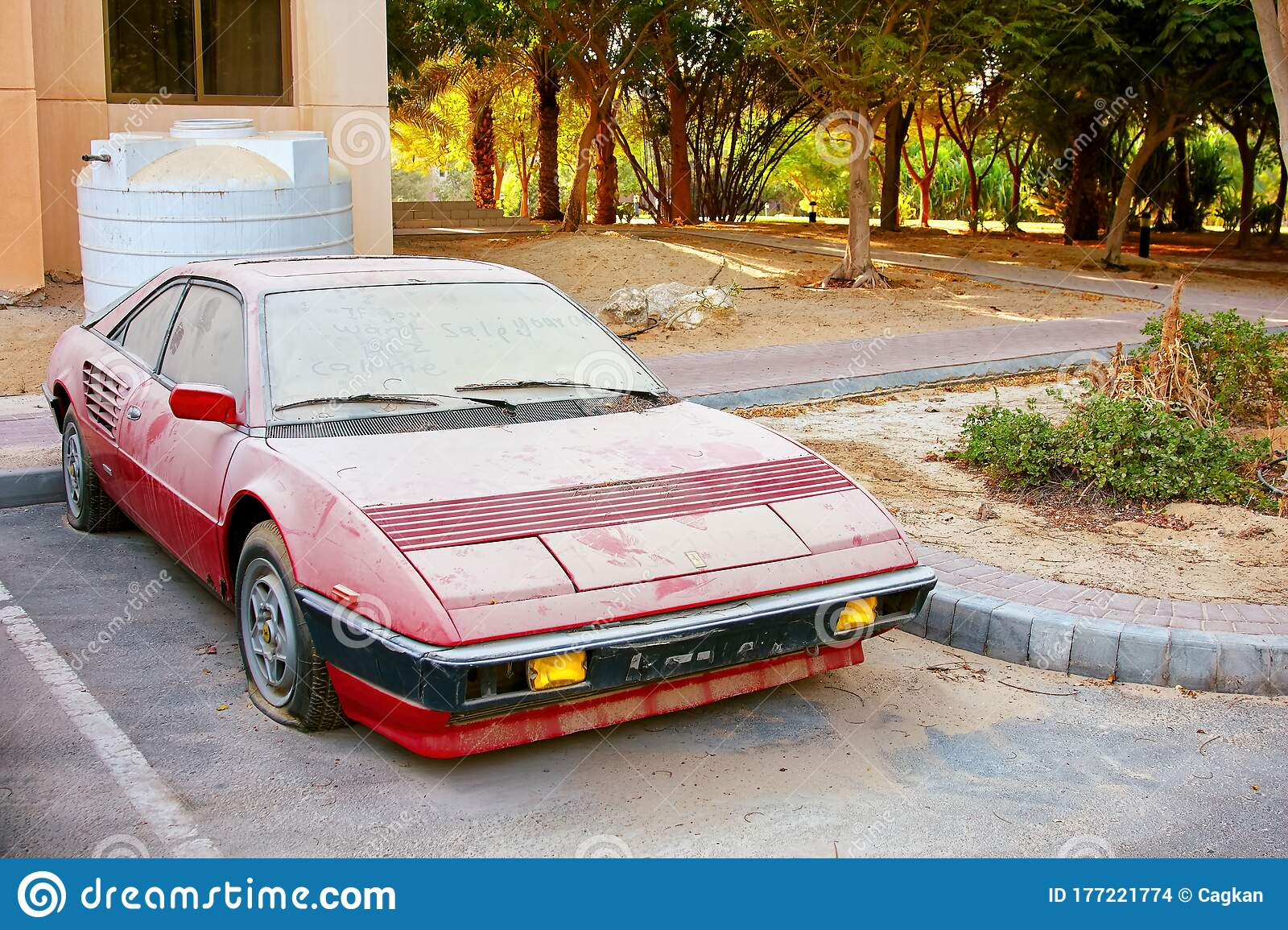 Abandoned Ferrari Car Covered With Dust In The Parking Lot Editorial Stock Image Image Of Grunge Dubai 177221774