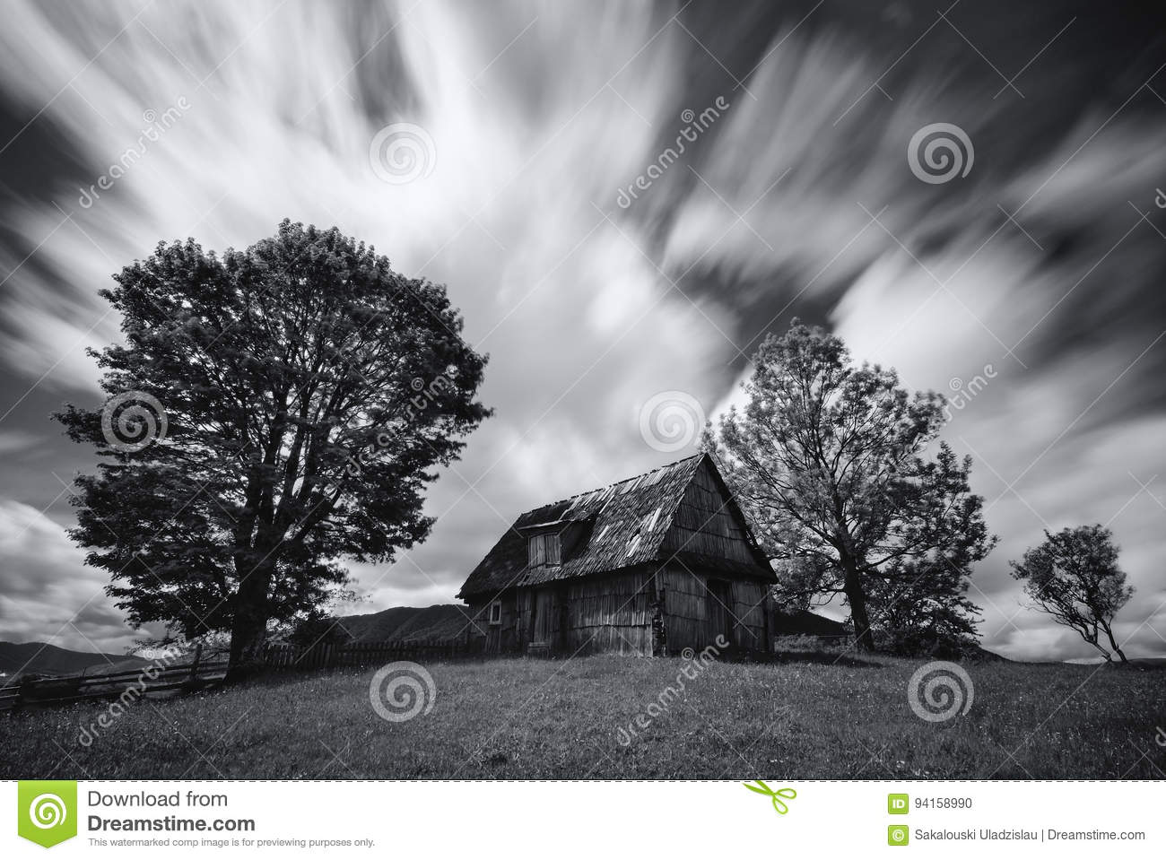 Abandoned house in West Ukraine.Old spooky abandoned farm house in black-white color. An old, long-abandoned house,against the bac