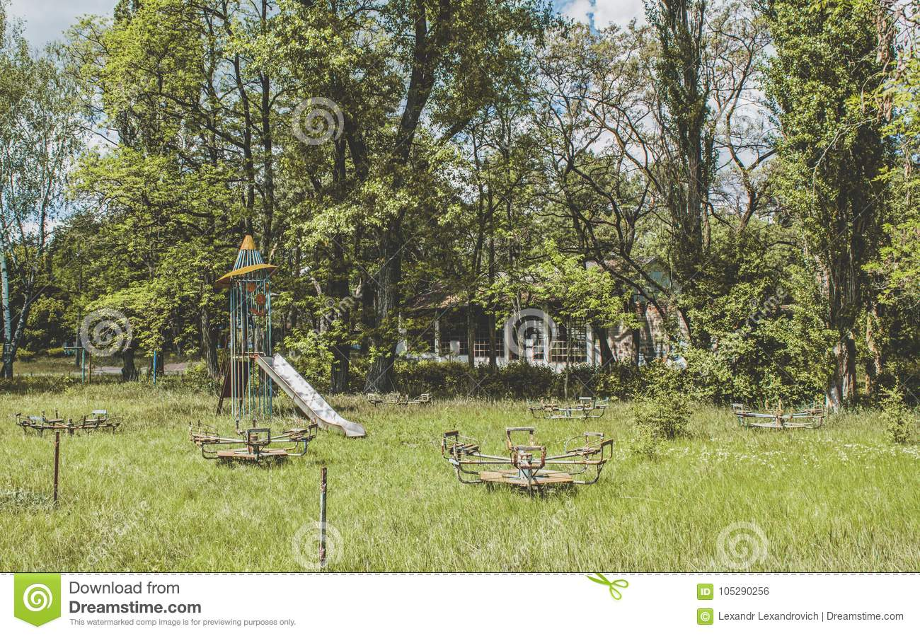 Abandoned Kids Playground In The Forest In Ukraine Stock Photo Image Of Scary Blue 105290256