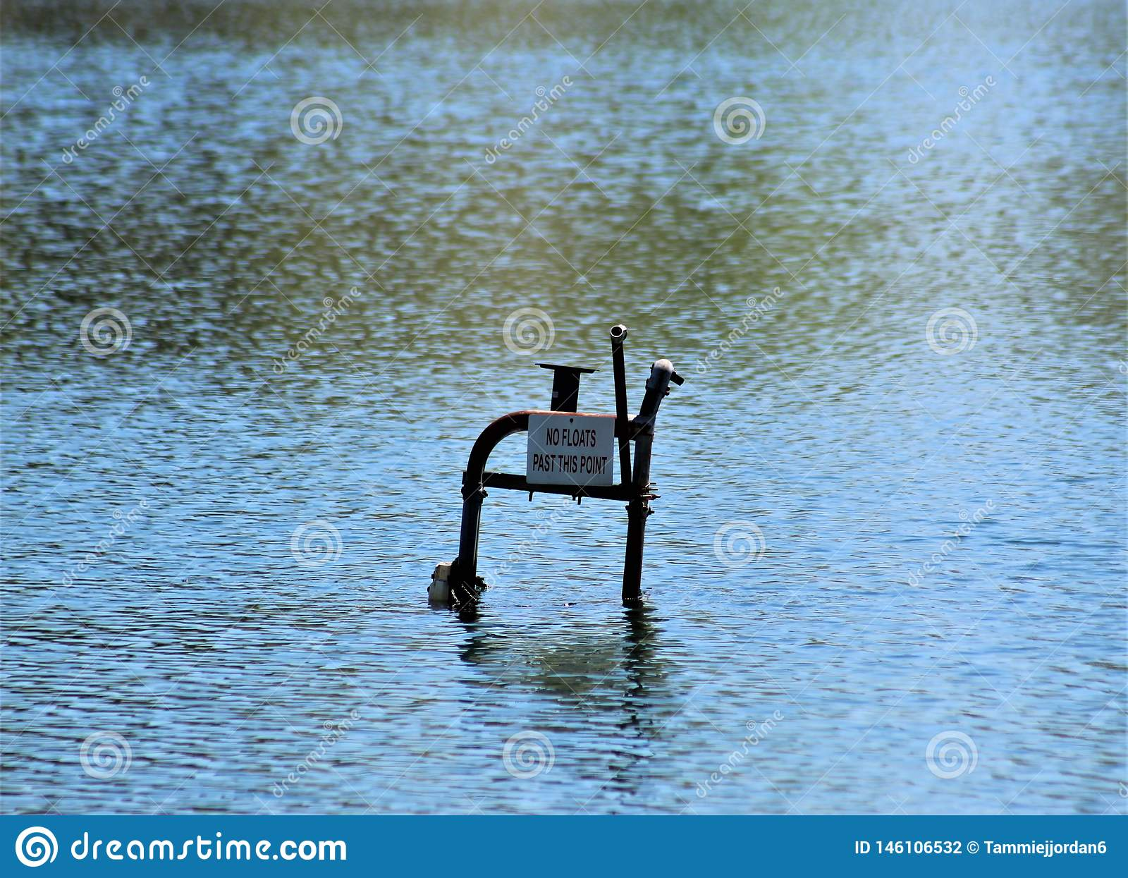 Abandoned Lifeguard`s Chair Sinking into the Lake