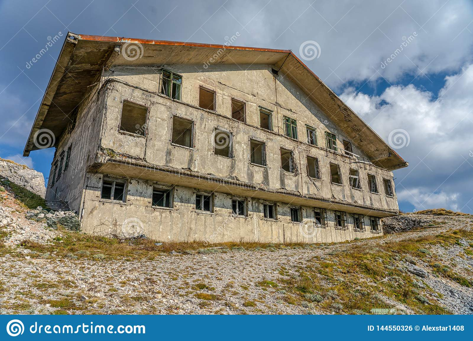 Abandoned Military Barracks on the mountain side in the clouds