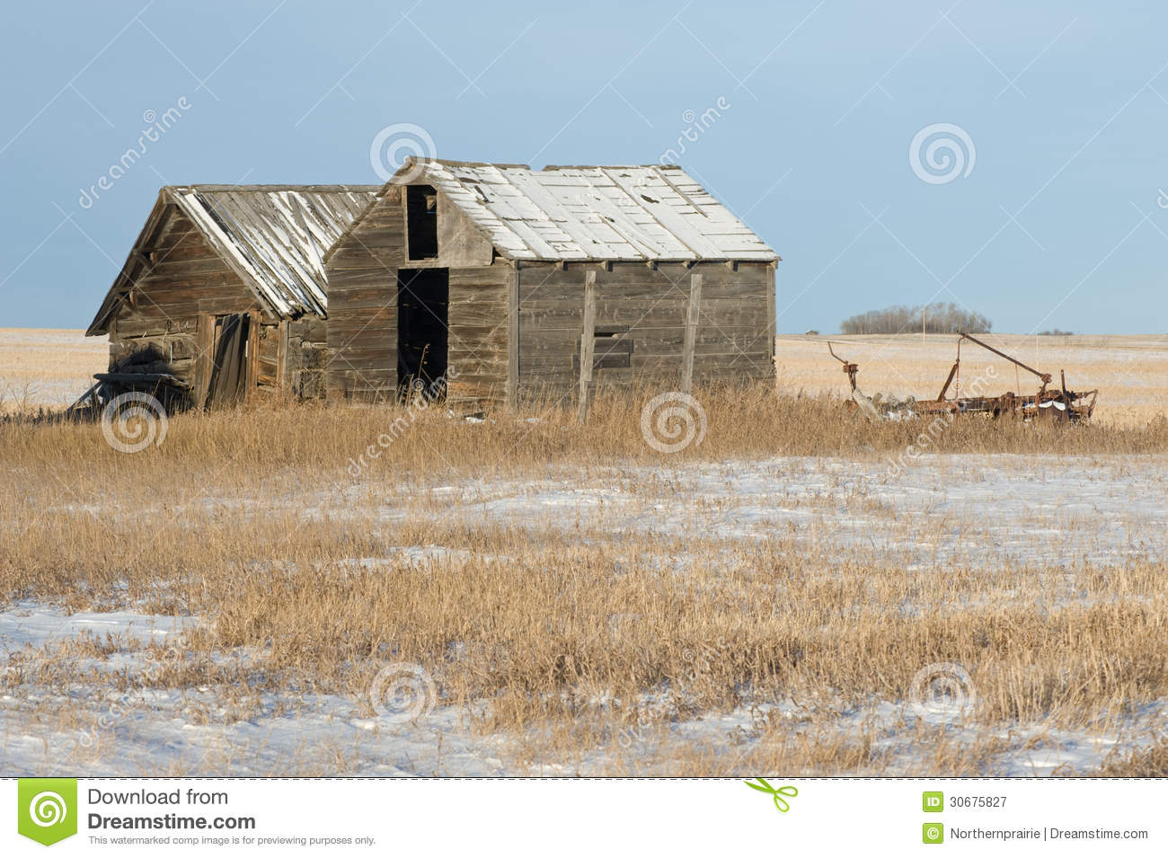 Abandoned Old Sheds And Farm Machine In Winter Royalty