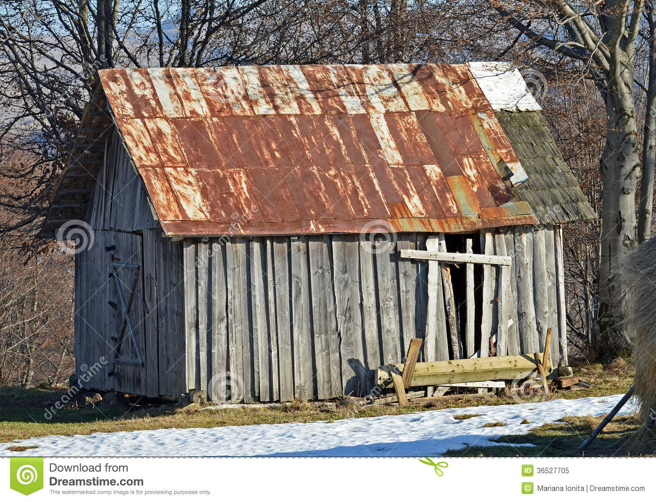 Abandoned Old Wooden Barn With Rusted Roof Royalty Free