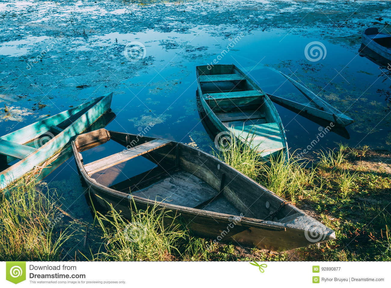 Abandoned old wooden fishing boats in summer lake or river download abandoned old wooden fishing boats in summer lake or river beautiful summer stock image publicscrutiny Image collections