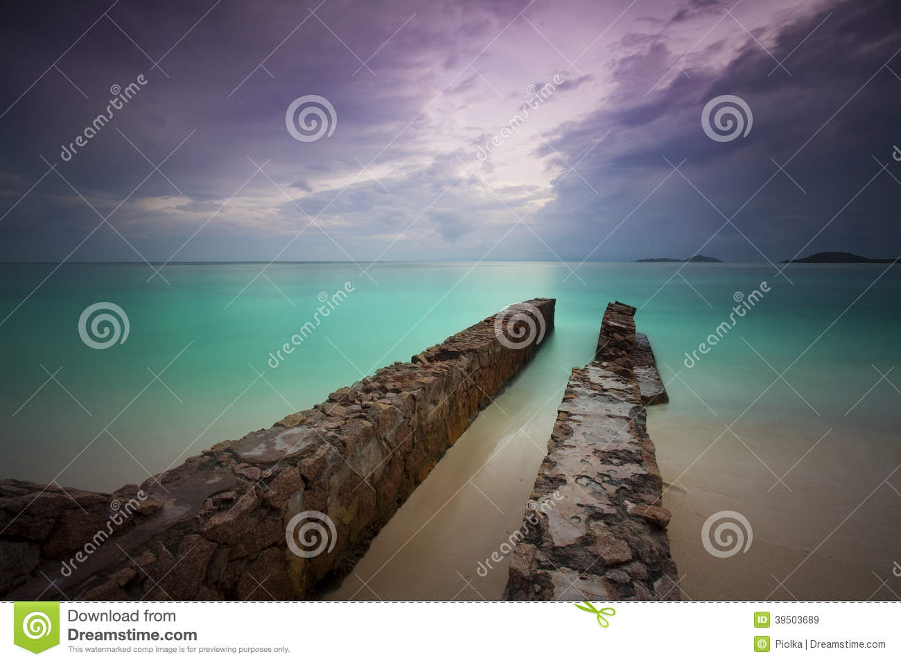 Abandoned pier at the beach
