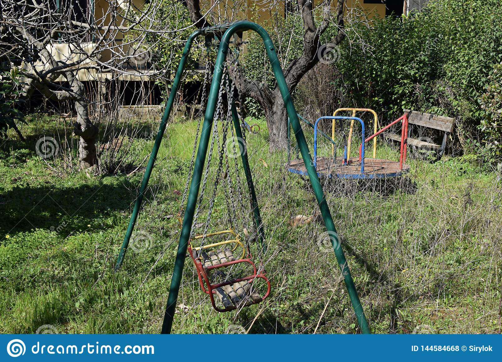 Abandoned Playground Old Swings And Merry Go Round Stock Photo Image Of Plants Decay 144584668