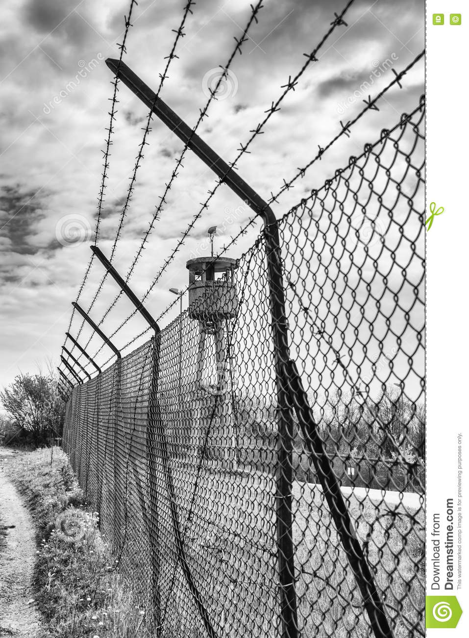 Abandoned Sentry Box Tower Isolated By A Net With Barbed Wire. Stock ...