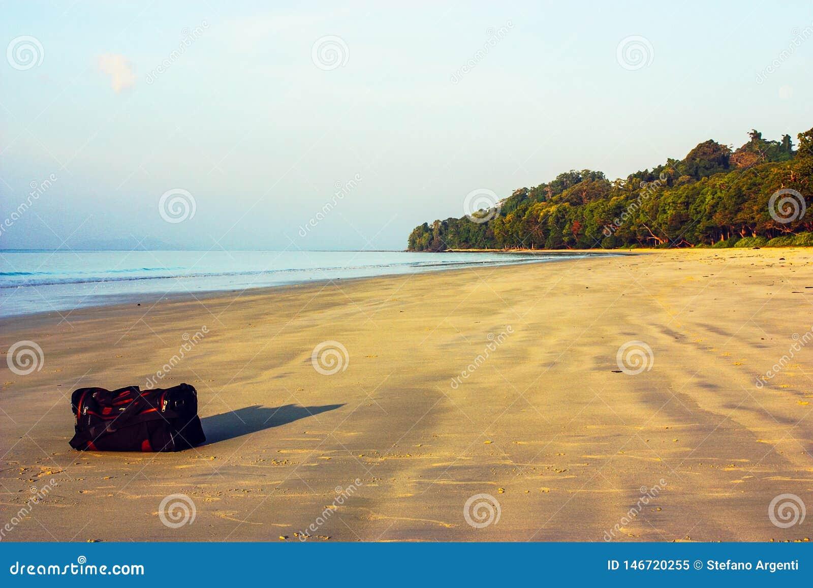 Travel bag on the beach