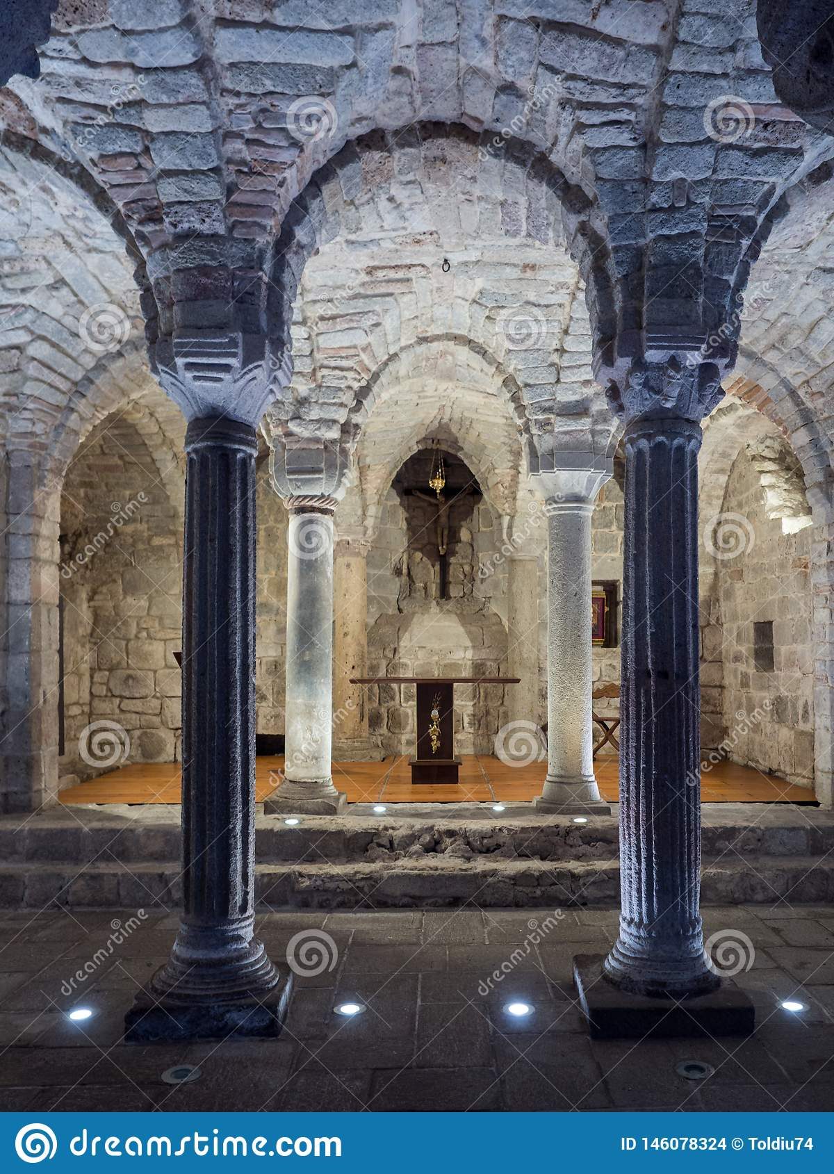Crypt of a medieval abbey with carved stone columns