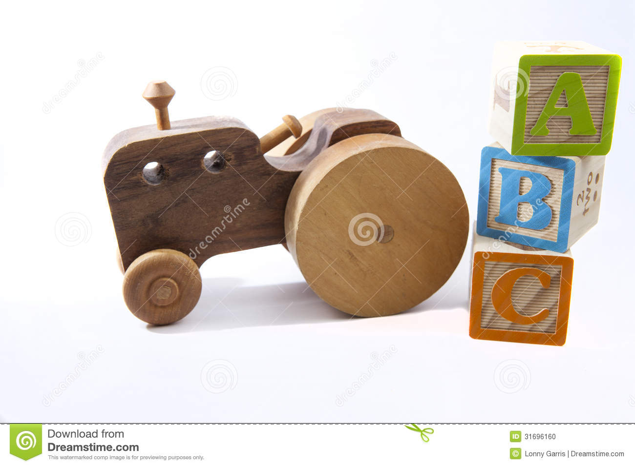 wooden toy abc blocks and old fashioned handmade wooden car or tractor ...
