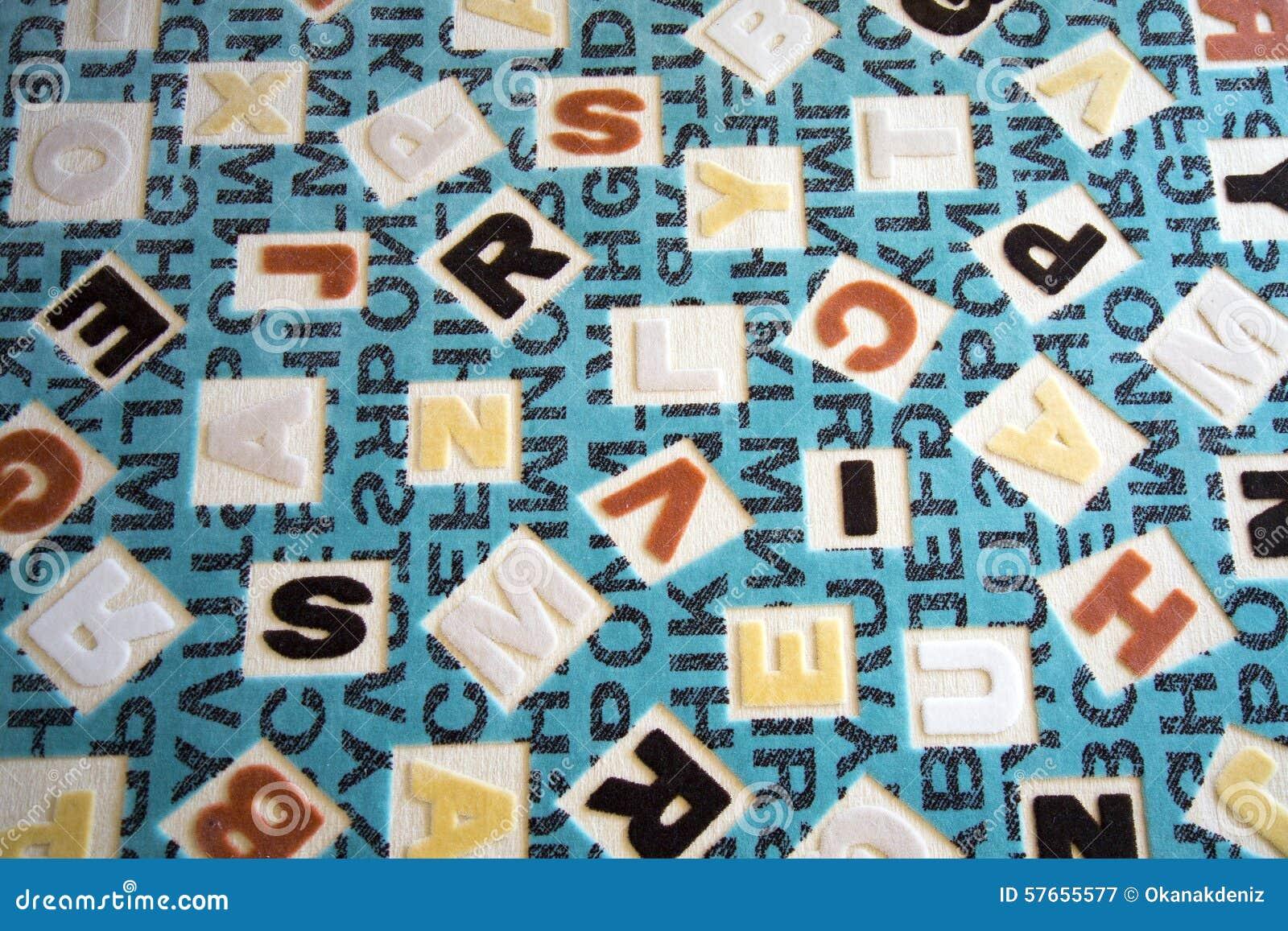 Abecadła na tkanina dywanu powierzchni