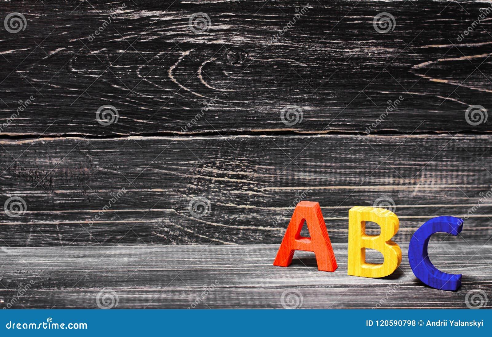 Abecadło robić drewno na tle deska, heban