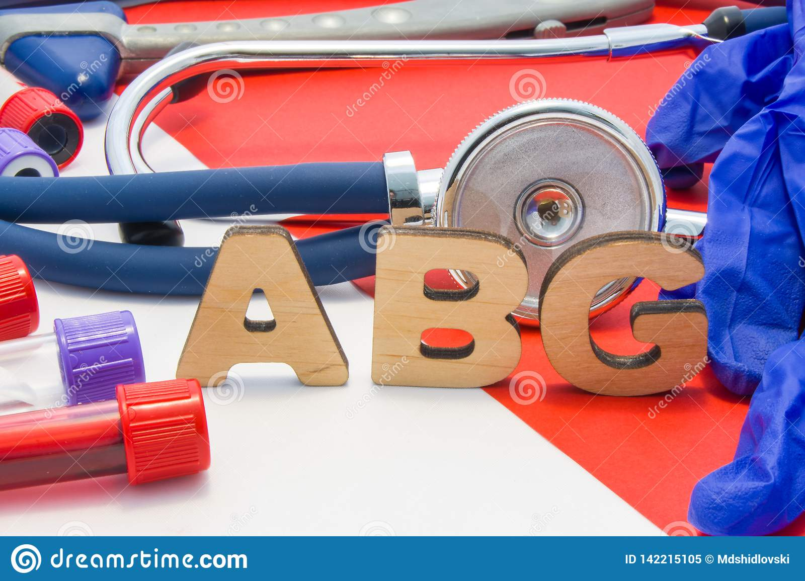 ABG medical abbreviation meaning arterial blood gas in blood in laboratory diagnostics on red background. Chemical name of ABG is